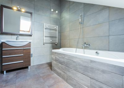 Fitted Bathroom With Stone Tiles